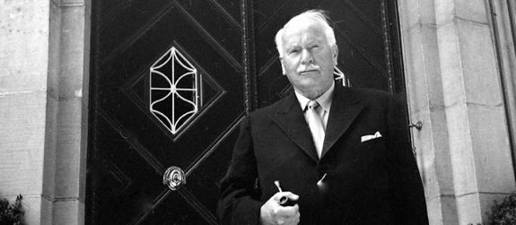 Photo of Carl Jung in front of his home is Kusnacht, Zurich, Switzerland