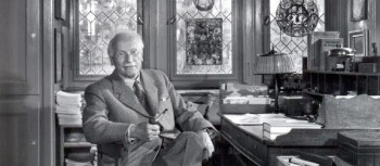 Photo of Carl Jung in his study in his home in Kusnacht, Zurich, Switzerland.
