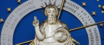 Image of a god-like figure in the centre of a zodiacal clock in a church in Germany.